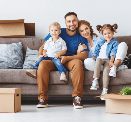 Family on Couch with Boxes