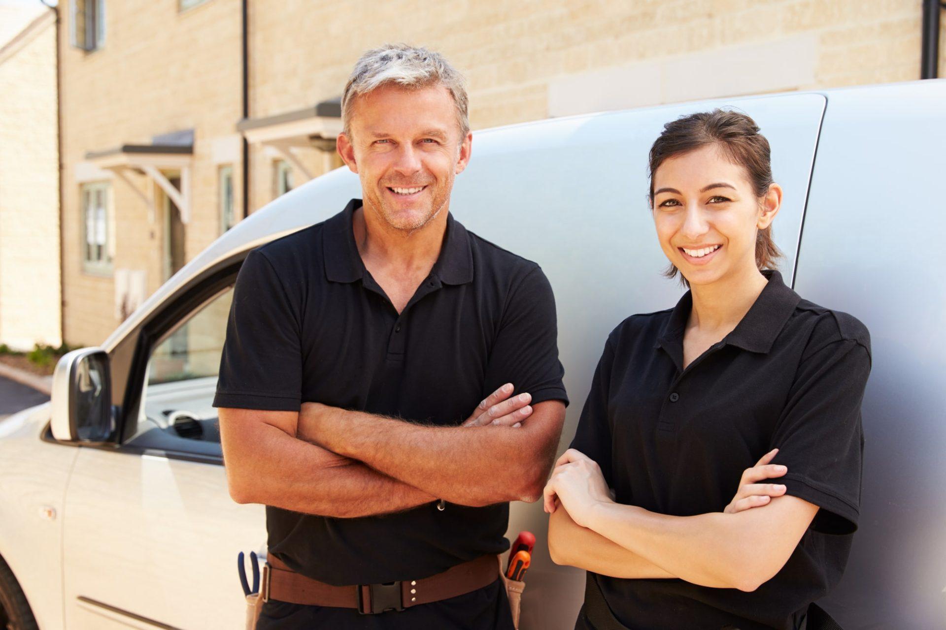 tradesman standing by van