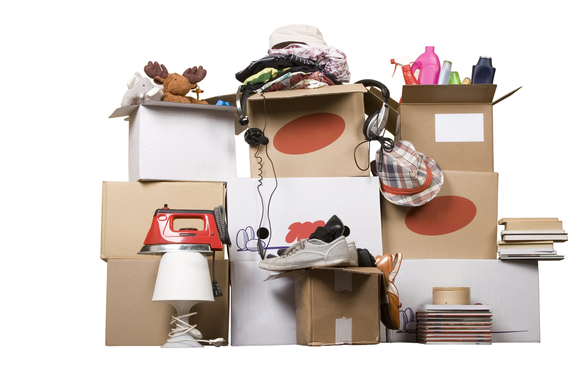 Messy stack of boxes with household items in
