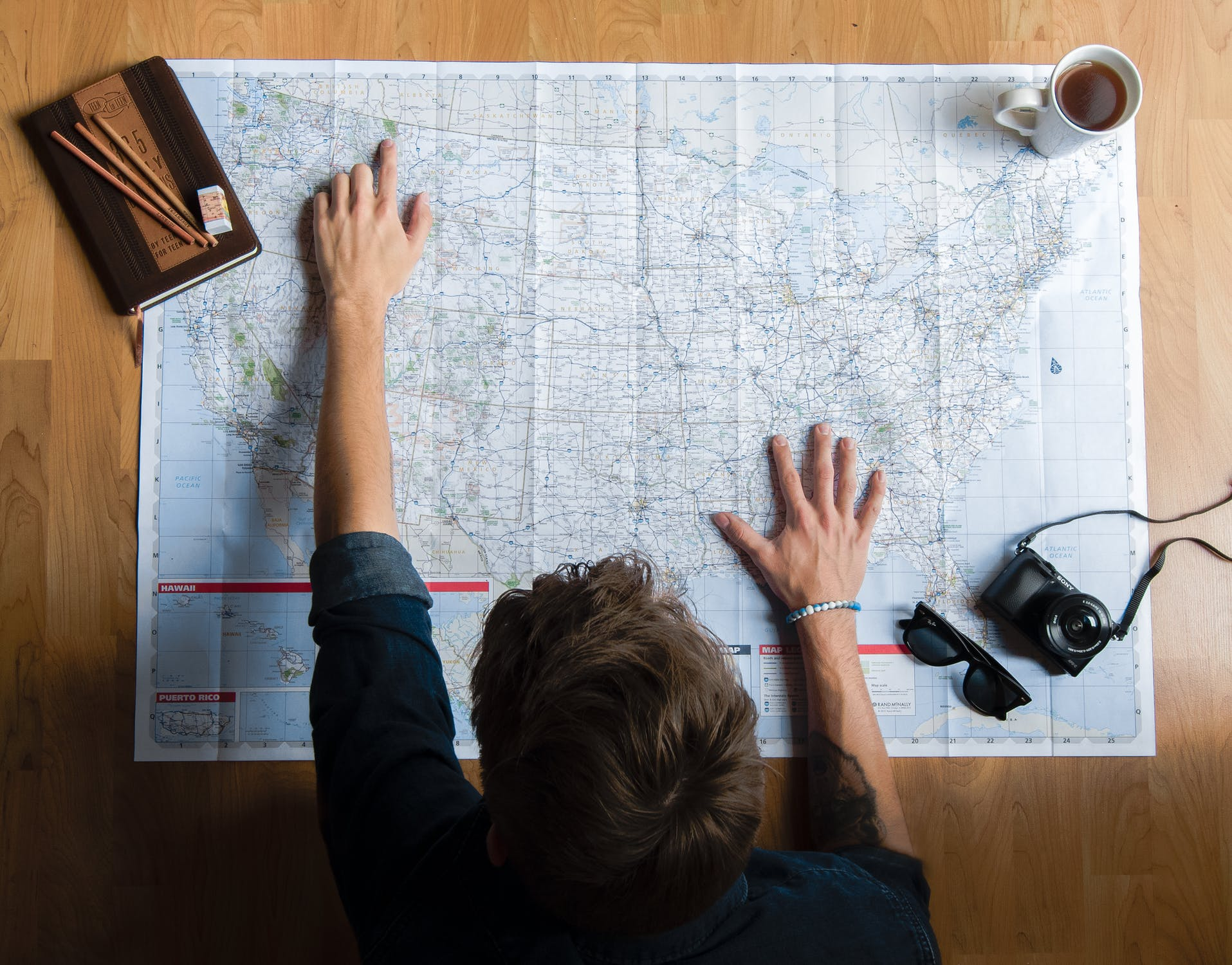 Person looking at map and planning journey