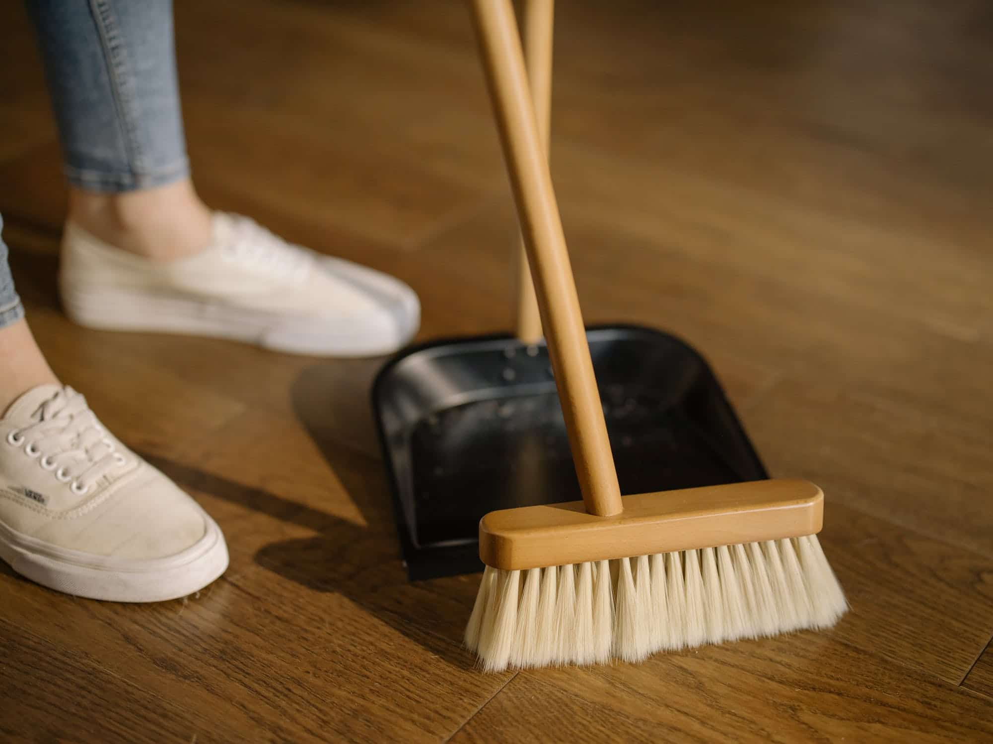 spring cleaning, sweeping the floor